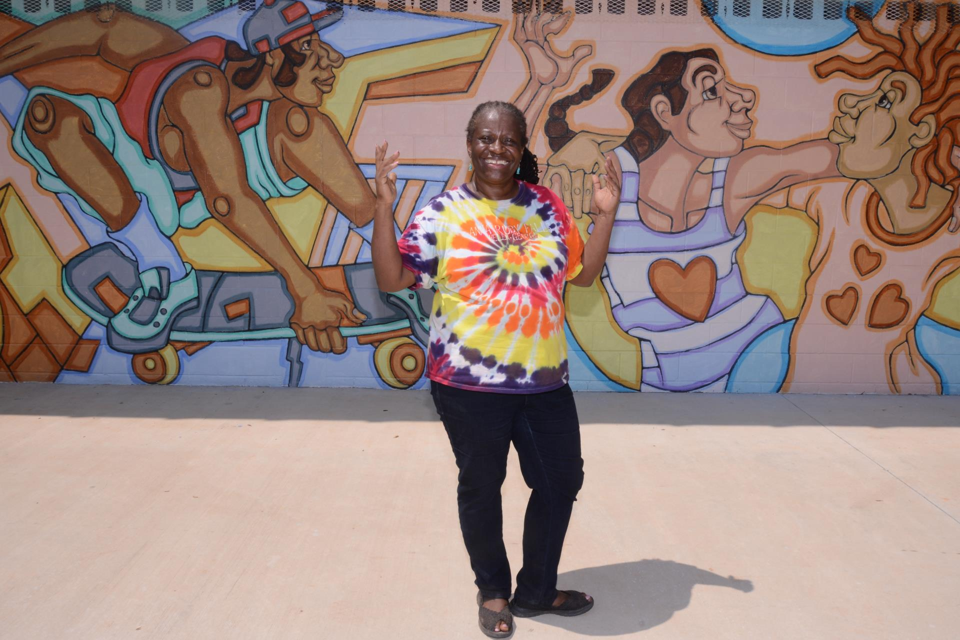 Councilmember Sheperd with mural at Langford Recreation center