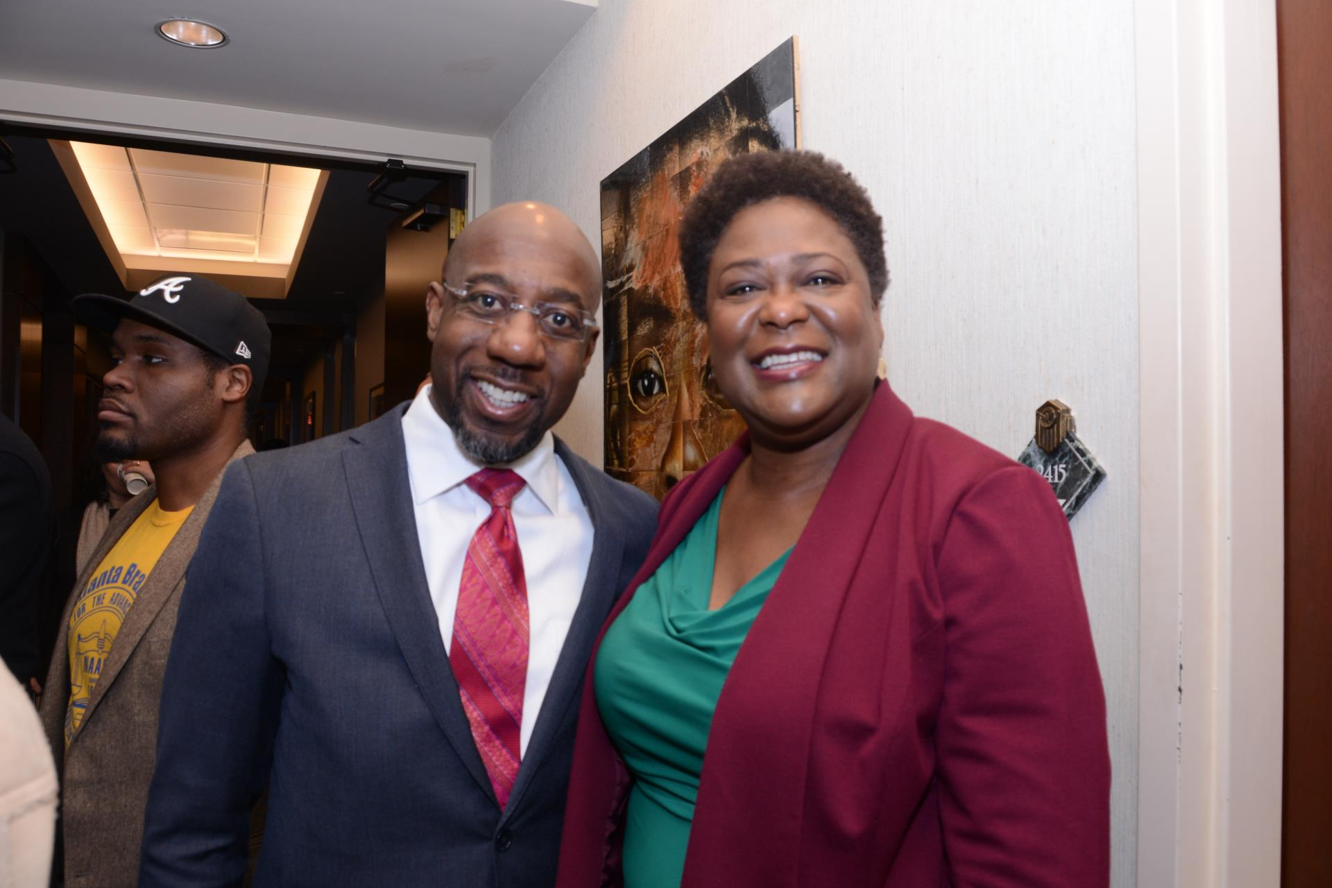 President Moore with Rev. Warnock