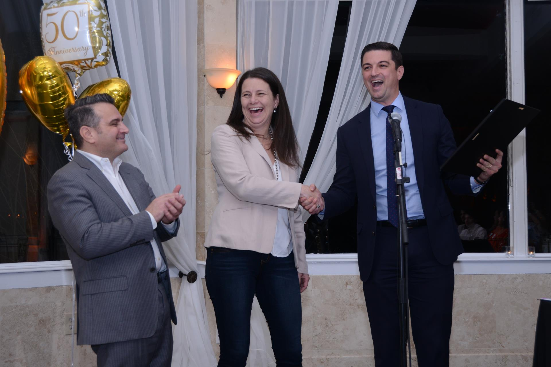 Midtown Neighbors President, Tony Rizzuto, Councilmembers Ide and Farokhi celebrate