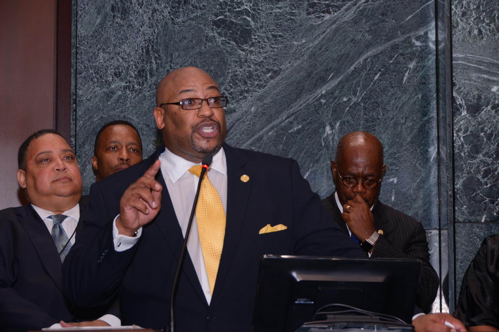 Clinton Rucker speaks in to the full council